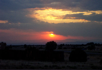 june 26, a break in the smoke shows the jemez mountains at sunset.